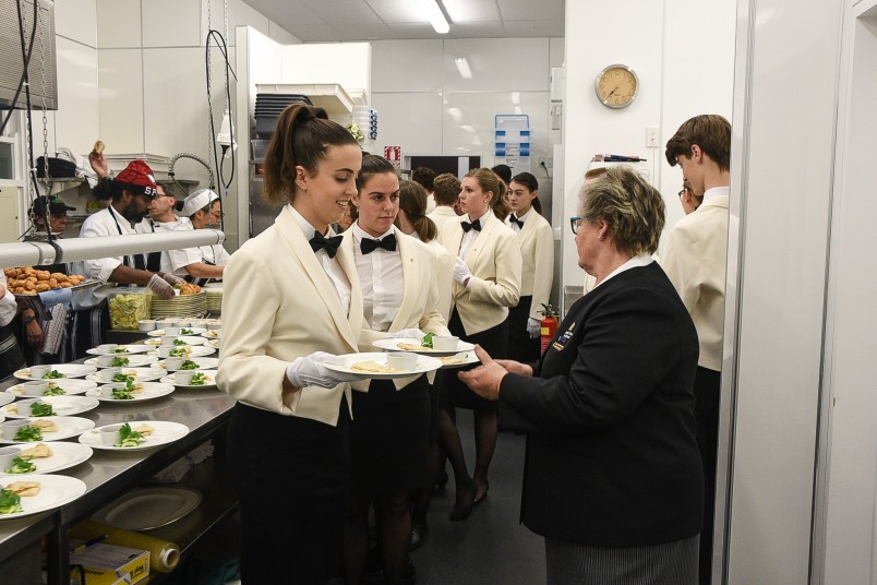 Image of Marion checking the plates before they go out to the guests