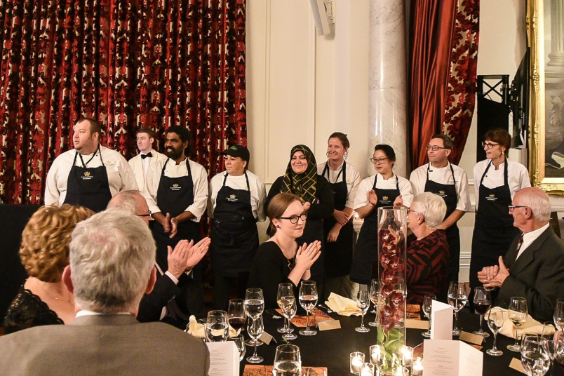 Image of the chefs being acknowledged by the guests