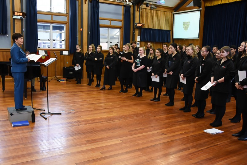 Image of Dame Patsy speaking to the choir