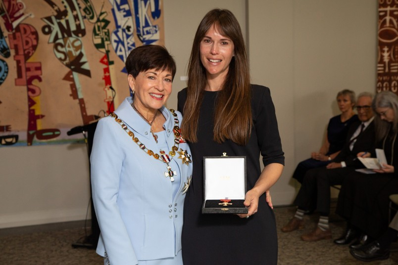 Julia Black receving the ONZM for the late Malcolm Black