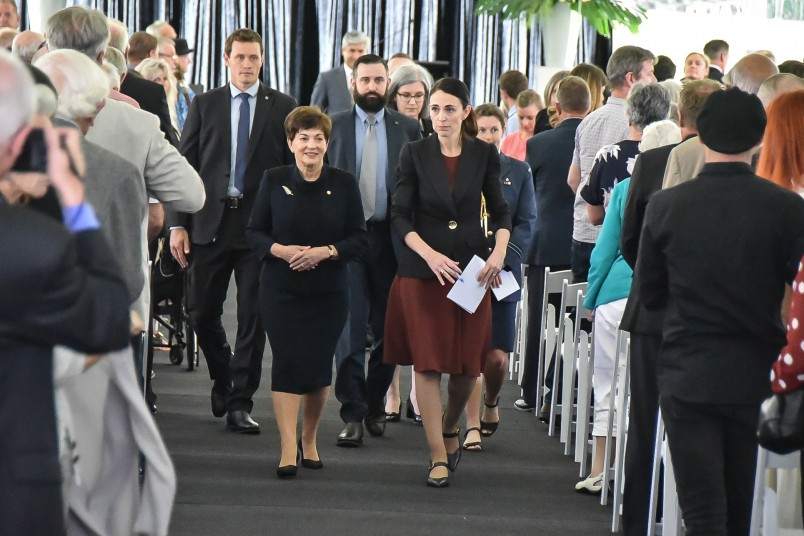 Image of Dame Patsy and the PM leaving the service