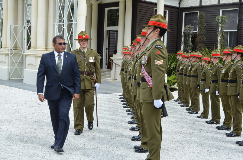 HE Dr Abdulla Mausoom inspecting the Guard of Honour