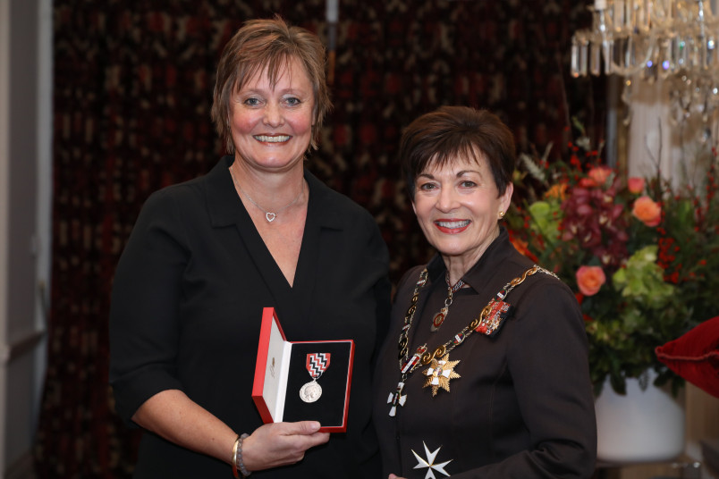 Sheryl Haughie receiving the late Rex Kirk's QSM for services to the community and sport