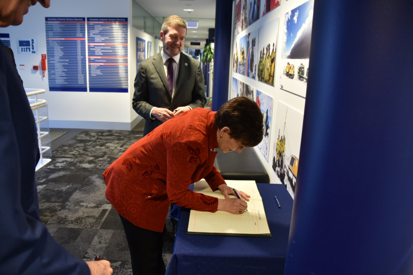 Image of Dame Patsy signing the Visitor Book at the Australian Antarctic Division