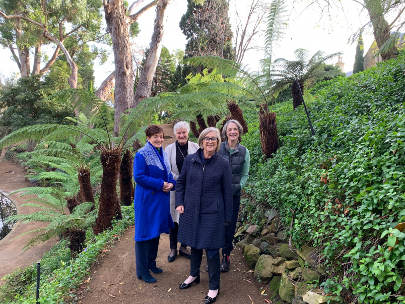 dame Patsy and others in the garden at Government House in Hobart