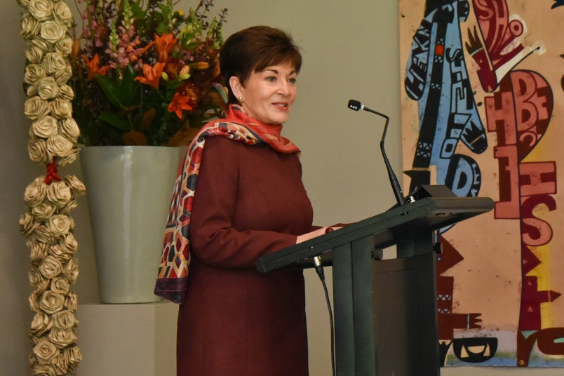 Dame Patsy speaks at a lectern