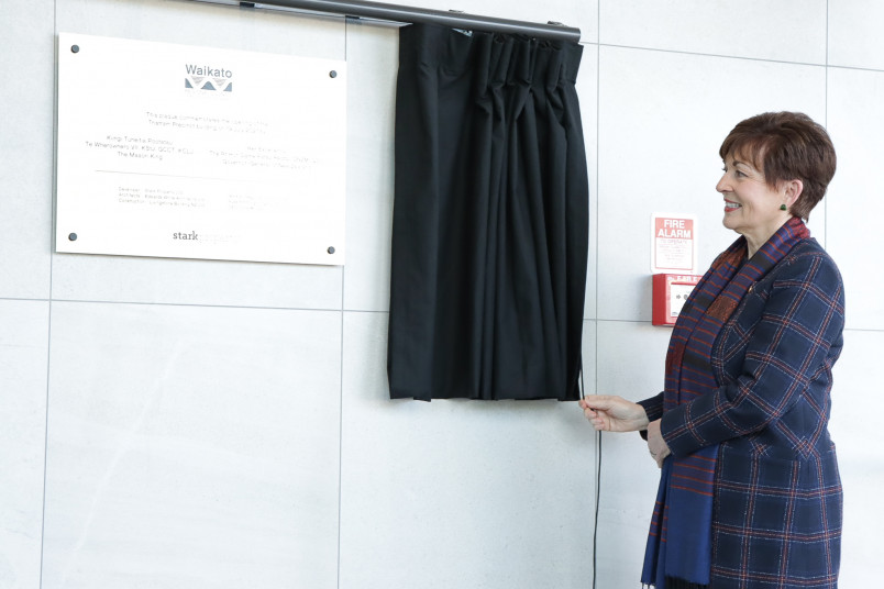 Dame Patsy unveiling the plaque at the Waikato Regional Council's premises