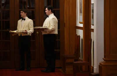 Image of wine waiters at an investiture dinner