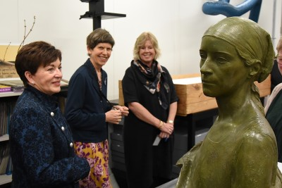 Image of Dame Patsy viewing a statue