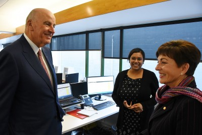 Image of Dame Patsy and Sir David meeting staff at the New Zealand AIDS Foundation