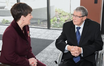 Image of Dame Patsy speaking with Jim Anderton