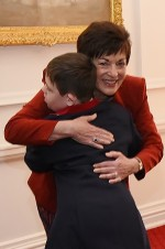 Image of Dame Patsy receiving a hug from Frances Clarke Award recipient, Fletch Gallagher