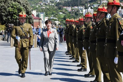 an image of Dame Patsy inspecting the Guard of Honour