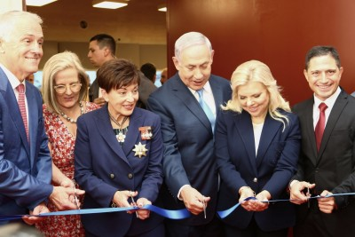 An image of The official party cuts the ribbon to open the Anzac Museum at Be'er Sheva