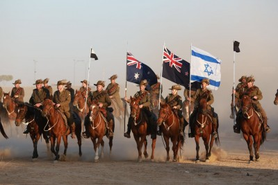 an image of Light Horse re-enactment with Australian, NZ and Israeli flags