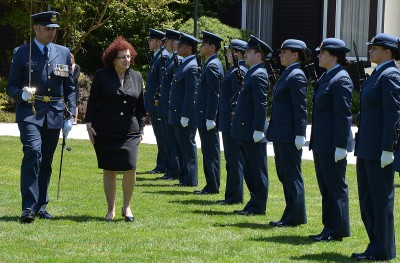 Image of the High Commissioner of Cyprus, HE Mrs Martha Mavrommati inspects the Guard of Honour