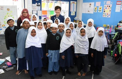 Image of Dame Patsy with the youngest pupils