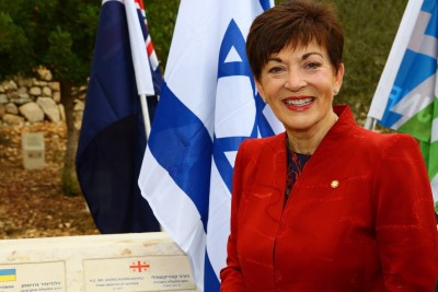 an image of Dame Patsy at the Grove of Nations, where she planted an olive tree