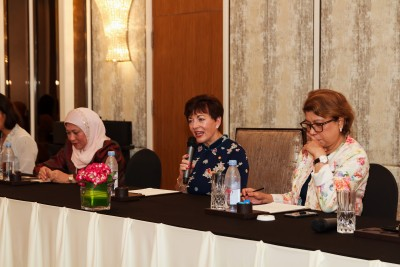 an image of Dame Patsy and Government Minister Nancy Shukri and moderator Tan Sri Datuk Dr Rebecca Fatima Santa Maria