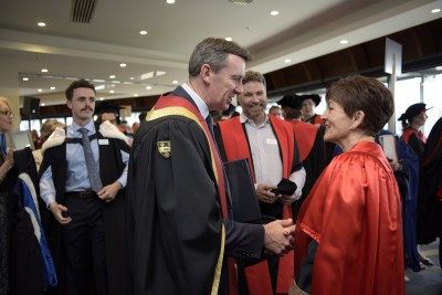 Image of Dame Patsy being congratulated by Pro-Chancellor Neil Paviour-Smith