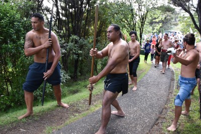 an image of Warriors leading the official party to Maiki Flagstaff