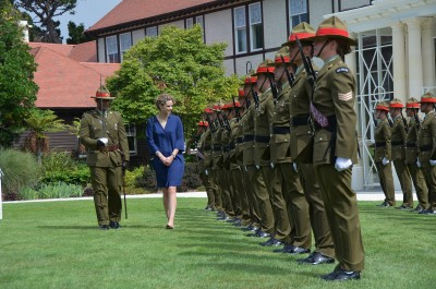 an image of HE Ms Laura Mary Clarke inspecting the guard of honour