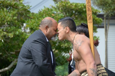 an image of HE Mr Johnson Naviti greeting a member of the cultural party