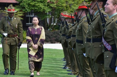 an image of HE Ms Nur Izzah Wong Mee Choo inspecting the Guard of Honour
