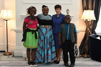 Image of the High Commissioner of the Republic of South Africa, HE Vuyiswa Tulelo and family with Dame Patsy