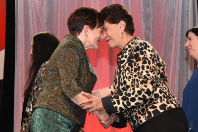an image of Dame Patsy meeting a member of the Onuku Maori Lands Trust