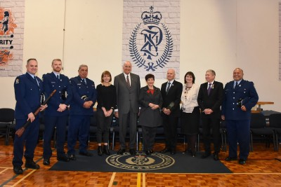 an image of Dame Patsy and Sir David with senior police personnel and college instructors