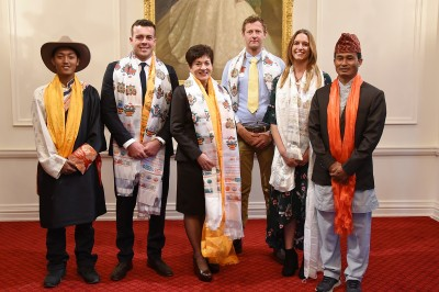 Image of Dame Patsy with recipients and guests after the presentation of Nepalese scarves