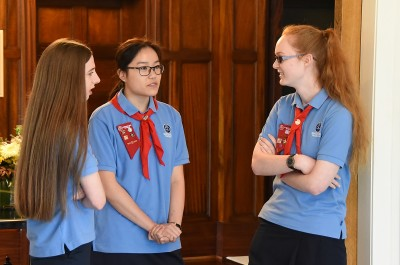 Image of  Girl Guides chatting before their award presentation