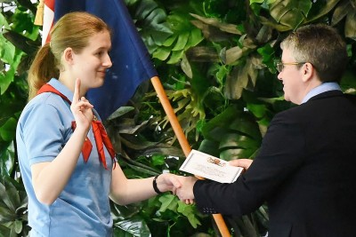 Image of a Girl Guide doing the Girl Guide salute