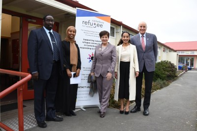 an image of Dame Patsy and Sir David with the managers of the Refugee Resource Centre