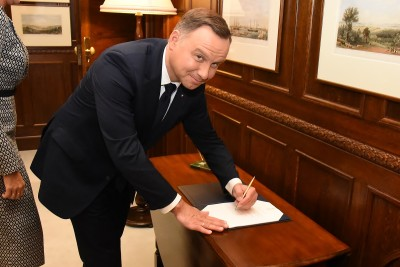 Image of President of the Republic of Poland, HE Andrzej Duda signing the Visitor Book