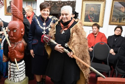 Image of Dame Patsy with Dame Tariana, who is Wearing a cloak and holding the sword of Te Keepa, a link to Queen Victoria