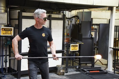 Image of Philip Stokes demonstrating glass blowing