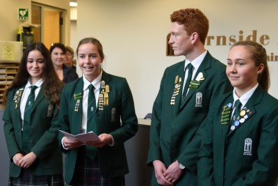 Image of Dame Patsy being welcomed by Burnside High School student leaders
