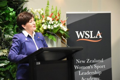 an image of Dame Patsy speaking to guests