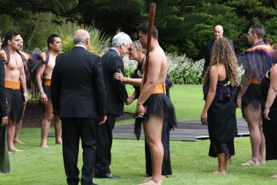 an image of President Pinera greeting a member of the cultural party