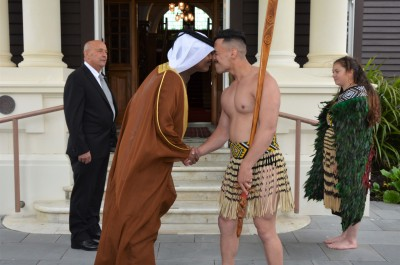 an image of HE Mr Saad Abdullah Al Mahmoud Al Shareef greeting a member of the cultural party