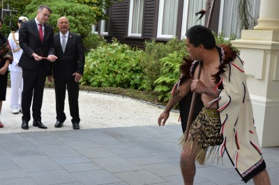an image of HE Mr Jurij Rifelj, Ambassador of the Republic of Slovenia is led by a member of the cultural party