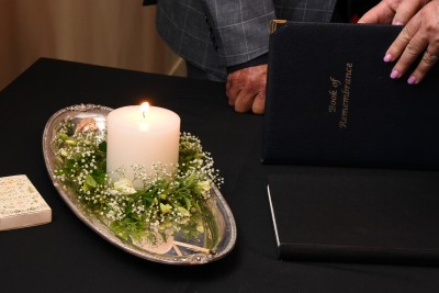 an image of Memorial candle and memorial book