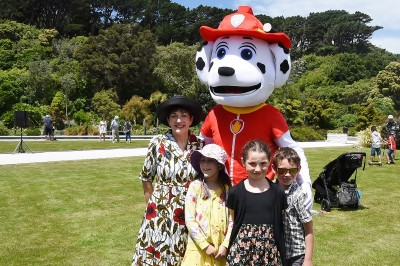 Image of Dame Patsy and co cuddling up with Marshall from 'Paw Patrol'