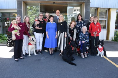 Image of Dame Patsy and the Canine Friends Pet Therapy volunteers and dogs