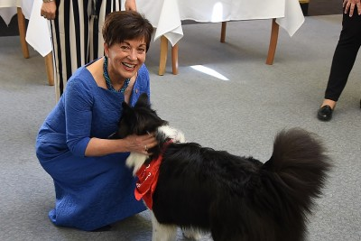 Image of Dame Patsy with Jack the Border Collie