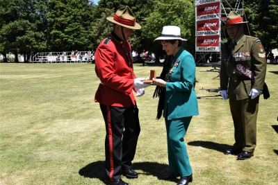 an image of Dame Patsy presenting the Governor-General's medal to Officer Cadet Benjamin Falk