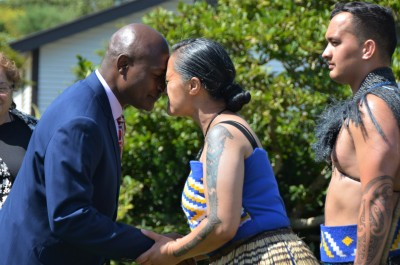 an image of HE Mr Frank Francis Bwalya greeting a member of the cultural party