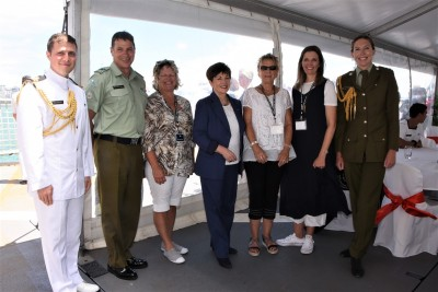 an image of Dame Patsy with service personnel and guests from Devonport Hospice